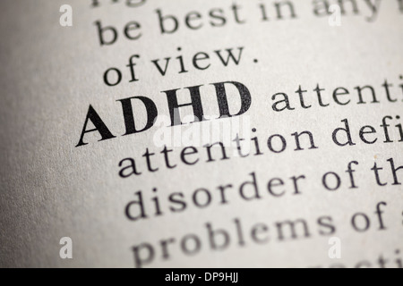 Fake Dictionary, Dictionary definition of the word ADHD. Attention deficit hyperactivity disorder - Stock Photo