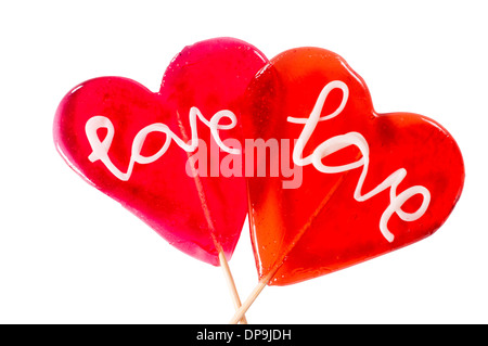 ... Couple of heart shape lolly pops isolated on white background - Stock Photo