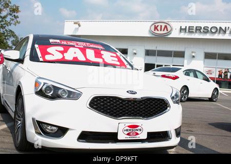 A Kia dealer lot in suburban Maryland.  - Stock Photo
