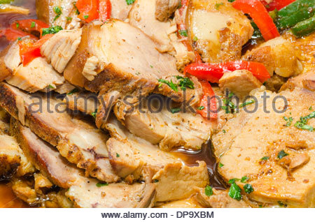 Close up on a fountain of roasted pork in a banquet hall - Stock Photo