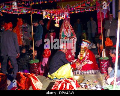 Mother and bridegroom at traditional Hindu Gaddi Himachal Pradesh village wedding, Kereri,  Northern India. - Stock Photo