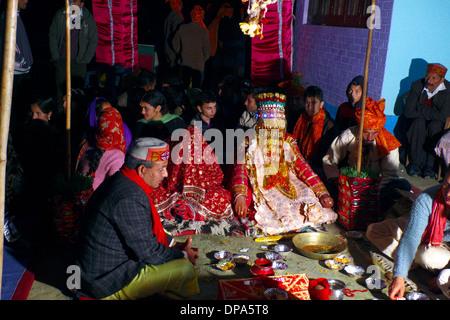 Bridge and groom at traditional Hindu Gaddi Himachal Pradesh village wedding, Kereri,  Northern India - Stock Photo