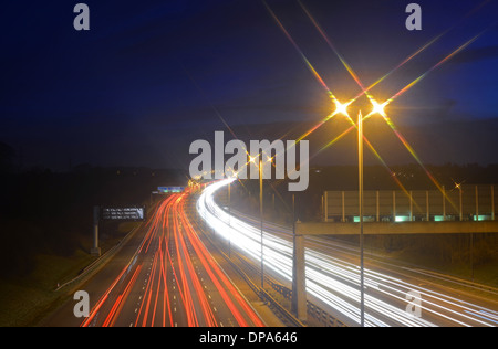 traffic headlight trails of traffic on the A1/M motorway Leeds Yorkshire United Kingdom - Stock Photo