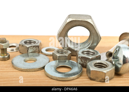bolts and nuts on the wooden desk - Stock Photo