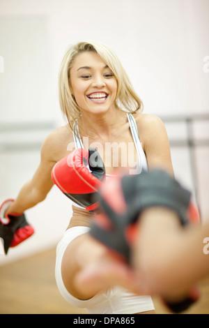 Young woman kickboxing - Stock Photo