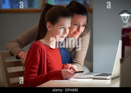 Girl using laptop computer - Stock Photo