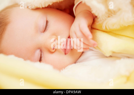 Baby in peaceful slumber - Stock Photo