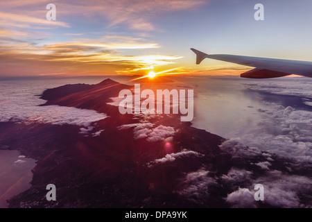 Tenerife, Canary Islands - sunset over the island from the flight back to Britain in the evening. - Stock Photo