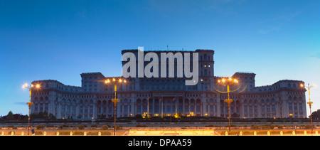 Palace of Parliament at dusk, Bucharest, Romania - Stock Photo