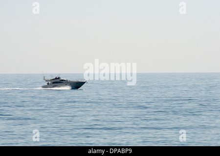 A small cruiser boat in the mediteranean sea - Stock Photo
