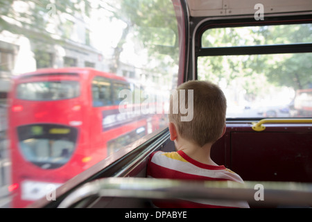 Young boy on double decker bus in London - Stock Photo