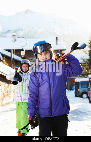 Two sisters carrying skis, Villaroger, Haute-Savoie, France