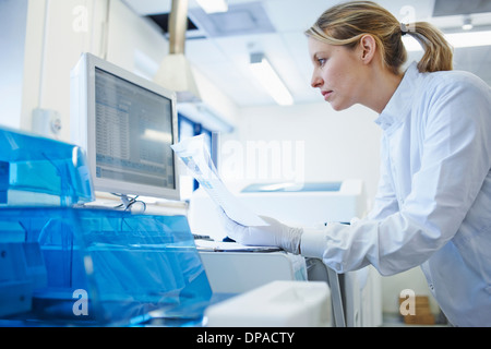 Researcher using computer - Stock Photo