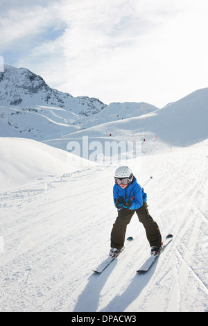 Boy skiing downhill, Les Arcs, Haute-Savoie, France - Stock Photo