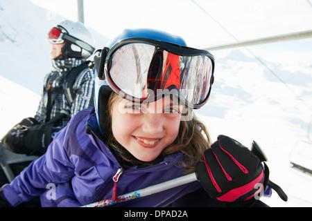 Portrait of young girl on ski lift, Les Arcs, Haute-Savoie, France - Stock Photo