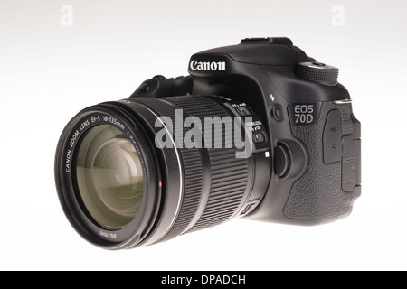 Digital photography equipment - Canon EOS 70D with zoom lens - Stock Photo