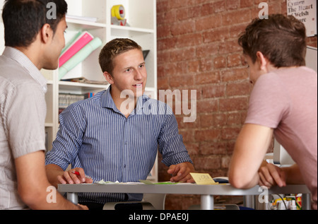 Three male colleagues in discussion Stock Photo