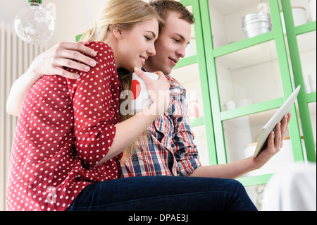 Couple on video chat using digital tablet - Stock Photo