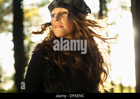 Portrait of young woman wearing hat spinning around Stock Photo