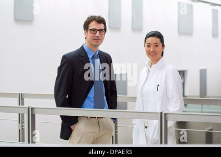 Portrait of two scientists in laboratory - Stock Photo