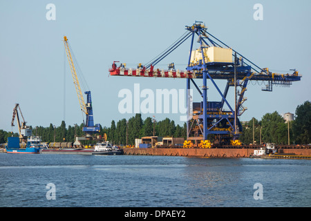 Dock cranes at the steelworks of ArcelorMittal Gent, world's largest steel producer, port of Ghent, East Flanders, - Stock Photo