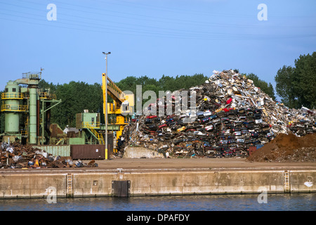 Scrapheap of recycled metal from dismantled cars at Van Heyghen Recycling export terminal, port of Ghent, East Flanders, - Stock Photo