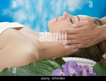 Side view of woman having head massage - Stock Photo