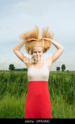 Woman throwing hair back - Stock Photo