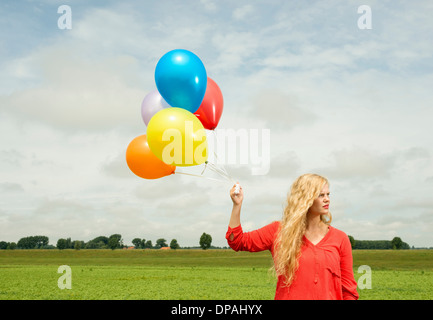 Woman with balloons - Stock Photo