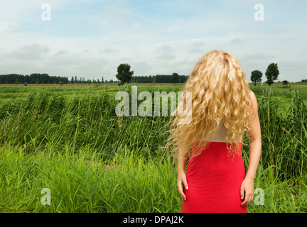 Woman with hair covering face - Stock Photo