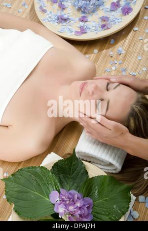 Woman having head massage - Stock Photo