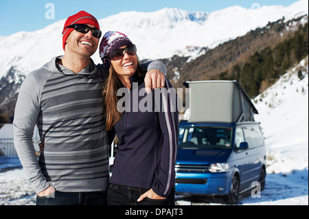Mid adult couple with car in background, Obergurgl, Austria - Stock Photo