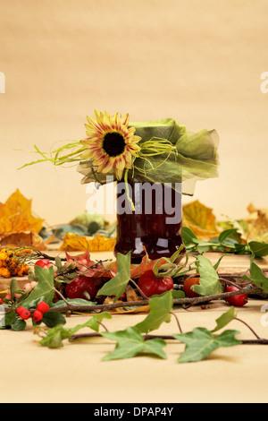 Autumn composition of fallen leafs, ivy, hawthorn, rowan etc. on a wooden board - Stock Photo