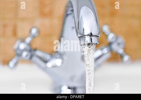 Chrome sink with modern design in bathroom