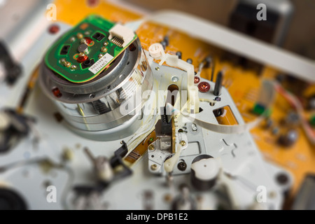 Video head inside old vhs recorder - Stock Photo
