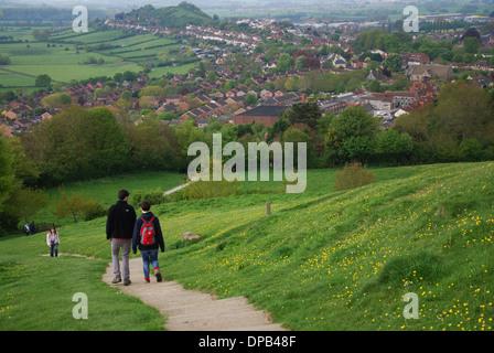 visitors climbing Glastonbury Tor, Somerset United Kingdom - Stock Photo