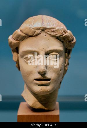 Apollo the eternally young god Terracotta from Taranto 500-400 BC Plate Greek Greece - Stock Photo