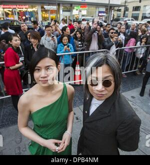Los Angeles, USA. 10th Jan, 2014. Director Peter Chan (R) and actress Michelle Chen arrive for the Hollywood TCL - Stock Photo