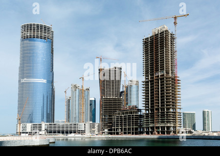 Many high-rise office and apartment towers under construction for new City of Lights at Al Reem Island new CBD in - Stock Photo