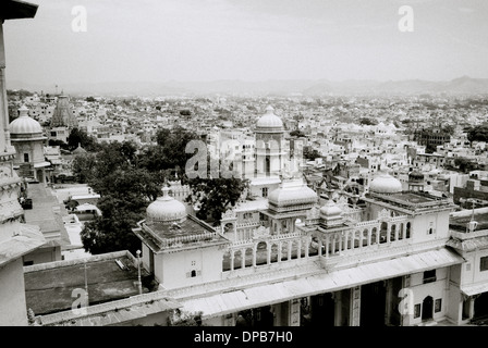 A view over Udaipur from City Palace in Udaipur in Rajasthan in India in South Asia. Cityscape Indian Travel Vista - Stock Photo