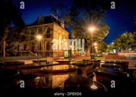 Exterior of the older building of the South Australian Museum in Adelaide at night. - Stock Photo