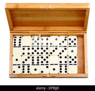 set of dominoes in bamboo box isolated on white background - Stock Photo
