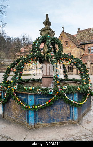 decorated so-called _easter fountain_ displaying twigs and painted eggs, maulbron monastery, maulbronn, baden-wuerttemberg - Stock Photo
