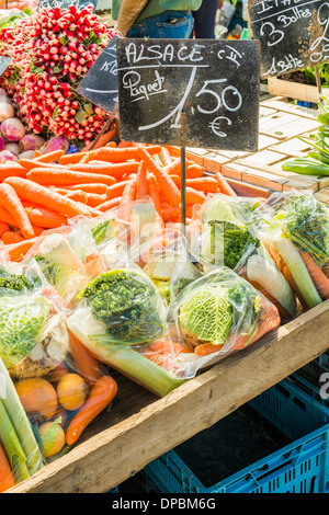 alsatian radishes, carrots and cabbages for sale at an outdoor market, mulhouse, alsace, france - Stock Photo