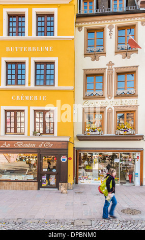 stores in historical buildings with renaissance facades, place de la reunion, mulhouse, alsace, france - Stock Photo