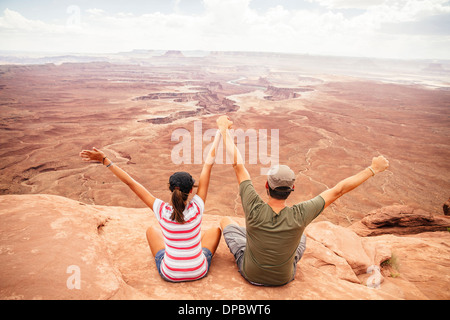 USA, Utah, Young couple looking over Canyonlands National Park - Stock Photo