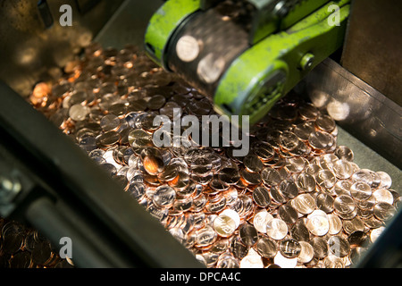Penny manufacturing at the Philadelphia branch of the United States Mint.  - Stock Photo