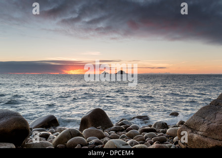 Sunset at Porth Nanven Cove near Lands End in Cornwall - Stock Photo