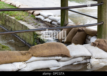 Sand Bags protecting Houses Due to Local Flooding - Stock Photo