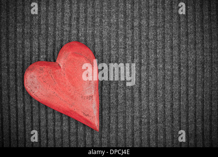 Red Wooden Heart on Knitted Background. Copy Space. Toned Image - Stock Photo